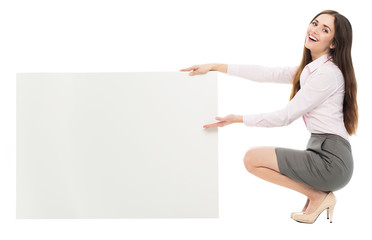 Woman crouching next to blank board