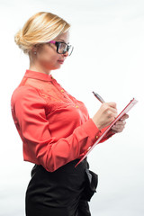 business woman in glasses writes on the tablet