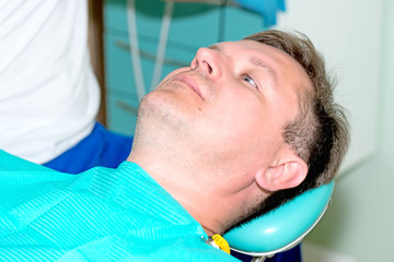 man in dentist office waiting for procedure