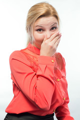 Woman pinches her nose to block a bad smell
