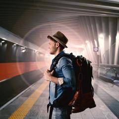 man waiting on platform
