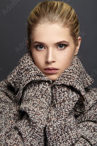 Close-up portrait of beautiful girl in knit sweater - 81484306