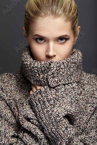 Close-up portrait of beautiful girl in knit sweater