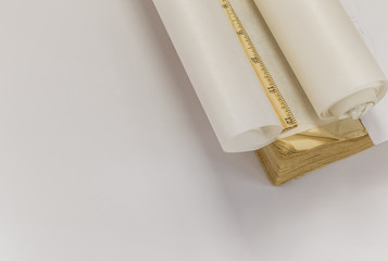 Ruler, tracing paper roll and old book