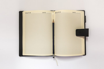 Diary and pensil on a white background