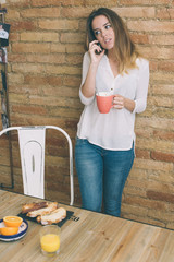 Talking on the phone while having a cup of coffee