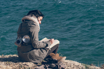 Woman writing during a cold winter morning in a Mediterranean cl