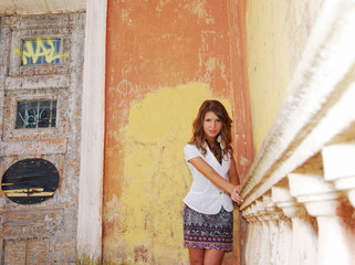 girl on the background of old wall with graffiti