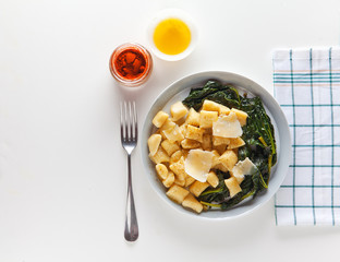 potato gnocchi with turnip greens and cheese