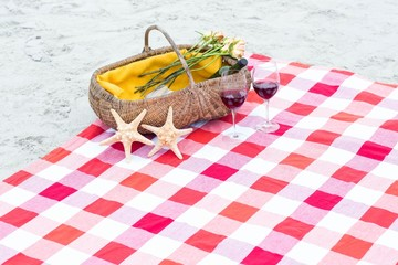 Picnic basket with glasses of red wine