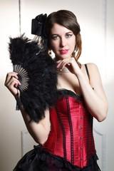 Beautiful woman cabaret burlesque showgirl portrait with fan