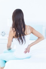 Brunette woman suffering from back pain