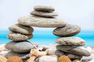 Door of stones on the beach