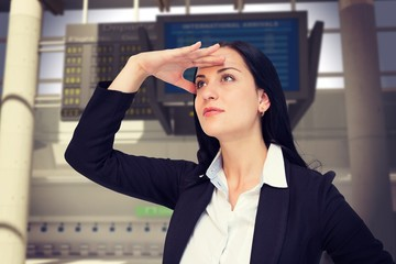 Composite image of pretty businesswoman looking with hand up
