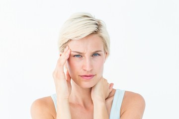 Blonde woman suffering from headache and neck ache