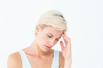 Pretty woman suffering from headache