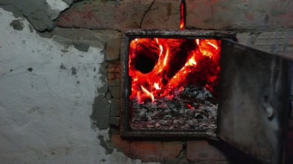 Firewoods burn in oven