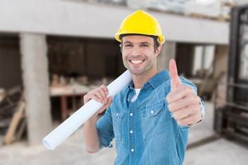 Smiling architect holding blueprint