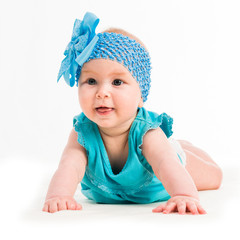 baby girl in blue decoration on the head