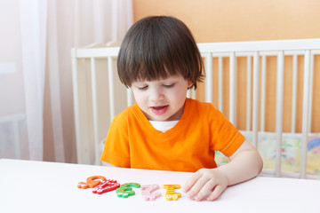 Little boy learns to count. Educational game