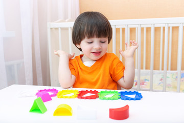 2 years boy plays logical toy