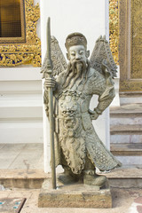 man with weapon statue in temple