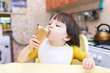 Nice little boy age of 2 years eats ice-cream cone on the kitche