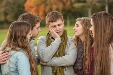 Perplexed Teen with Friends