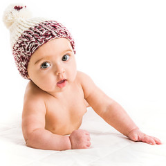 baby girl in a brown hat