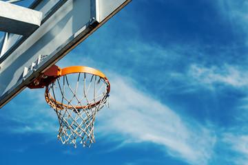 Basketball hoop agaist blue cloudy sky with copy space.