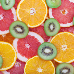 tropical fruit cut circles as background