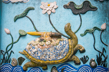 wall sculptures at Ngoc Son Temple