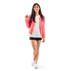 Casual brunette woman wearing black shorts and pink duvet isolat