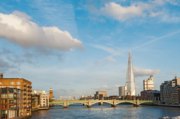 London skyline on Thames river in a sunny day.