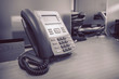 black telephone on table work of office - 81495554