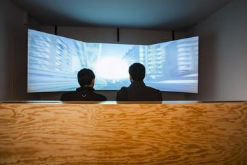 men watching screen