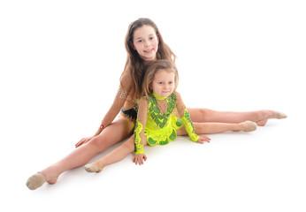 Beautiful little gymnasts doing exercise