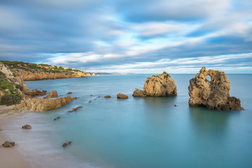 Sea bay with views of Albufeira. Blurred clouds at sunset.