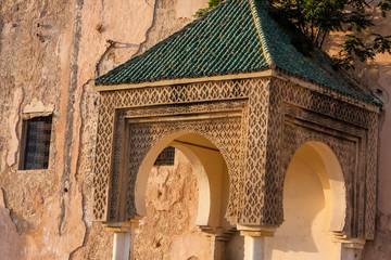 hood ornament on the walls of the medina of Meknes, Morocco