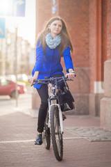 woman drives on bike