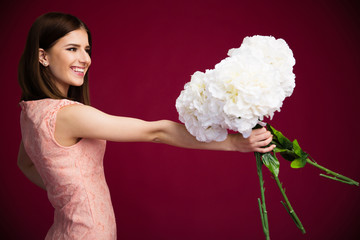Smiling charming woman holding flowers