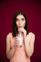 Young pretty woman drinking yogurt