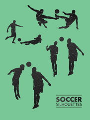 Soccer silhouettes in green vector