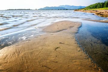 Sandbar on the shore by the sea