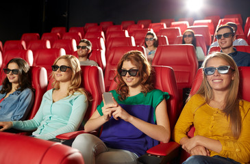 happy woman with smartphone in 3d movie theater