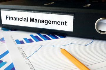 Graphs and file folder with label Financial Management.