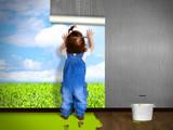 Funny child hanging wallpaper, doing repairs.