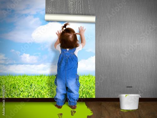 Funny child hanging wallpaper, doing repairs. - 81502100