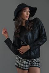 Hispanic fashion model posing at studio