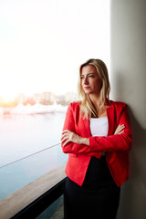 Confident businesswoman pensive looking out of office balcony